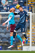 Kieran MacDonald (#3) of Raith Rovers FC wins a header against Liam Boyce (#10) of Heart of Midlothian FC during the SPFL Championship match between Raith Rovers and Heart of Midlothian at Stark's Park, Kirkcaldy, Scotland on 30 April 2021.