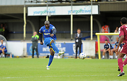 Wimbledon's Adebayo Akinfenwa shoots from distance - photo mandatory by-line David Purday JMP- Tel: Mobile 07966 386802 - 30/08/14 - Afc Wimbledon v Stevenage - SPORT - FOOTBALL - Sky Bet Leauge 2 - London - The Cherry Red Stadium