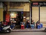 "22 DECEMBER 2017 - HANOI, VIETNAM: A ""pho"" shop in the old quarter of Hanoi. The old quarter is the heart of Hanoi, with narrow streets and lots of small shops but it's being ""gentrified"" because of tourism and some of the shops are being turned into hotels and cafes for tourists and wealthy Vietnamese.    PHOTO BY JACK KURTZ"