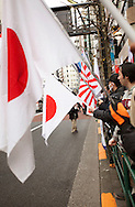 "February 5, 2017, Tokyo, Japan: An angry group of ultra-right wingers demonstrated in front of an APA Hotel branch in Tokyo due to the hotel chain's planned removal of a controversial history revisionist book from rooms hosting athletes of the 2017 Sapporo Asian Winter Games. The book in question written by Toshio Motoya, the hotel chain's Chief Executive, claims the 1937 Nanjing Massacre was a fabrication. Writing under the pen name Seiji Fuji, Motoya's book entitled ""Theoretical Modern History II"" is placed in every APA Hotel room in Japan and sold at their reception desks. The Tokyo based APA Hotel group is one of the largest hotel chains in Japan with over 400 hotels across the country. In the past 2-3 years APA has benefitted from a tourism boom to Japan in which 40% of their guests are foreign visitors and half that amount are Chinese and Korean nationals. As a result, China and Korea have been outraged by APA and a large boycott began in late January by both countries. This led to APA announcing they would pull Motoya's books from athlete's rooms only during the Asian Winter Games, infuriating Japanese right wingers. The demonstrators at this event are part of a group who call themselves ""Group of Warriors Protecting the Nation"" (Gokoku Shishi no Kai). Photo by Torin Boyd."