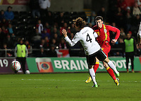 Pictured: Gareth Bale of Wales (R) takes a shot off target while being marked by Emanuel Pogatetz of Austria (L). Wednesday 06 February 2013..Re: Vauxhall International Friendly, Wales v Austria at the Liberty Stadium, Swansea, south Wales.