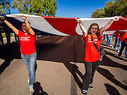 """11 NOVEMBER 2013 - PHOENIX, AZ: High school students carry an American flag at the Phoenix Veterans Day parade. The Phoenix Veterans Day Parade is one of the largest in the United States. Thousands of people line the 3.5 mile parade route and more than 85 units participate in the parade. The theme of this year's parade is """"saluting America's veterans.""""    PHOTO BY JACK KURTZ"""