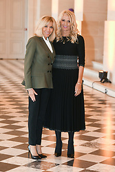 French President's wife Brigitte Macron welcomes Montenegro's President wife Lidija Dukanovic as they take part in a spousal event at the Chateau de Versailles in Versailles, near Paris, on November 11, 2018 as part of commemorations marking the 100th anniversary of the 11 November 1918 armistice, ending World War I. Photo By Laurent Zabulon/ABACAPRESS.COM
