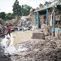A man stands among the ruins of housing caused by hurricane Eta in Chamelecón, San Pedro Sula. The building on the right is an evangelical church.<br /> <br /> Hurricanes Eta and Iota hit hard on the north coast of Honduras, leaving some areas flooded for three weeks, destroying people's furniture, belongings, vehicles and houses as well as standing crops.