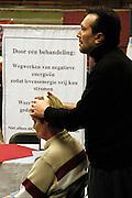 Nederland, Nijmegen, 2-3-2003..Magnetiseur op een paranormaal beurs...New age, bijgeloof, alternatieve geneeskunde..suggestie, gezondheid..Foto: Flip Franssen