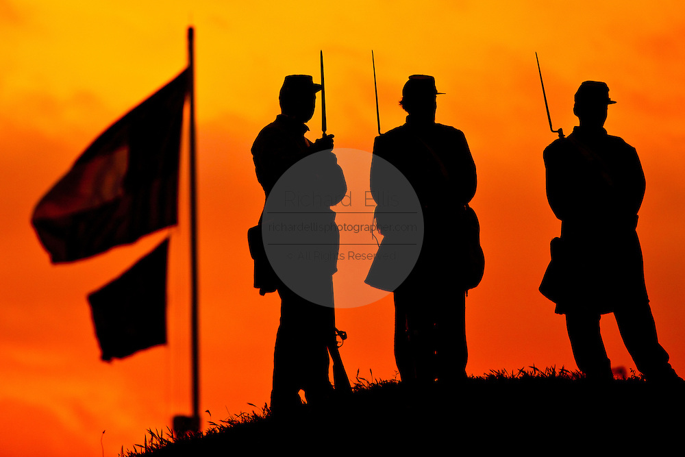 Confederate re-enactors silhouetted by the sunrise at Fort Moultrie  Charleston, SC on the 150th commemoration of the US Civil War.
