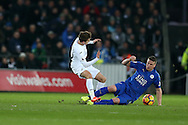 Robert Huth of Leicester city goes in two footed to foul Tom Carroll of Swansea city ® and gets a yellow card off the referee .Premier league match, Swansea city v Leicester City at the Liberty Stadium in Swansea, South Wales on Sunday 12th February 2017.<br /> pic by Andrew Orchard, Andrew Orchard sports photography.