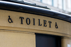© Licensed to London News Pictures. 31/05/2016. London, UK. Members of public walk past a public toilet in central London on 31 May 2016. A BBC investigation shows that some UK High Streets and public spaces no longer have any council-run public toilets and nearly 1,800 public toilets closed nationwide in the last 10 years. Photo credit: Tolga Akmen/LNP