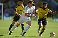 Federico Fernandez of Swansea City and Ikechi Anya of Watford compete for the ball. Barclays Premier League, Watford v Swansea city at Vicarage Road in London on Saturday 12th September 2015.<br /> pic by John Patrick Fletcher, Andrew Orchard sports photography.