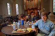 Ted Sikorski, an unemployed resident of the streets of Manhattan  with his typical day's worth of food at Holy Apostles Soup Kitchen in New York. (From the book What I Eat: Around the World in 80 Diets.) The caloric value of his typical day's worth of food in June was 2,300 kcals. He 5 feet, 8 inches tall; and 168 pounds. Although Ted spends many hours a day walking, he admits to having to watch his weight, adding that many of his ?residentially challenged? friends have the same problem. Over 1 million low-income residents use more than 1,200 nonprofit soup kitchens and food pantries in New York City. Some of the soup kitchens offer other benefits, such as showers, counseling, and entertainment. As in most big U.S. cities, it's easier to find a free meal in New York City than a place to sleep. Each night, more than 39,000 people sleep in the city's municipal shelter system, while thousands more sleep on the street. MODEL RELEASED.