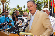 25 JUNE 2012 - PHOENIX, AZ:  Arizona State Representative ANDY BIGGS, a supporter of SB1070, responds to the US Supreme Court's decision overturning most of the law Monday. Biggs said he viewed the Court's decision as a victory because it let stand one small portion of the law. The case, US v. Arizona, determined whether or not Arizona's tough anti-immigration law, popularly known as SB1070 is constitutional. The court struck down most of the law but left one section standing, the section authorizing local police agencies to check the immigration status of people they come into contact with.      PHOTO BY JACK KURTZ