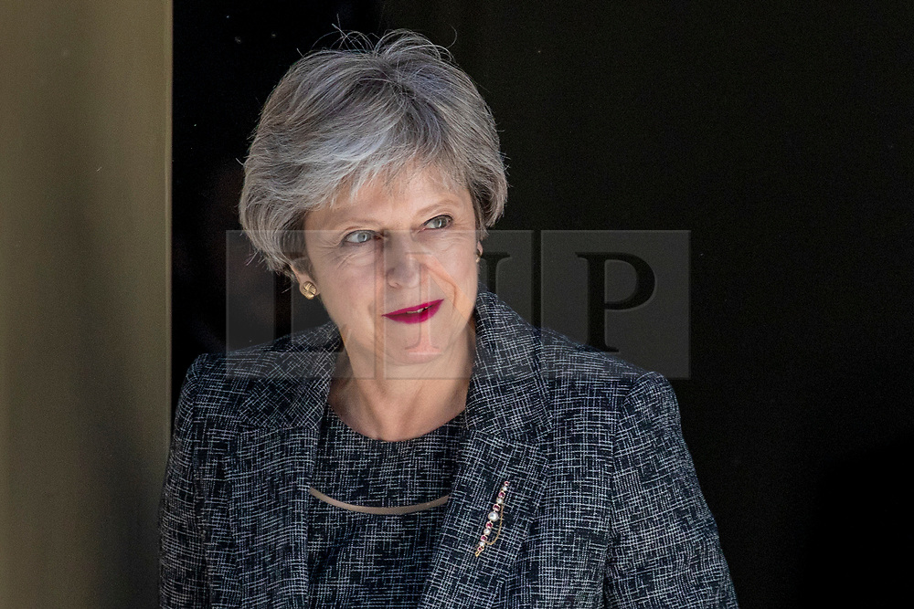 © Licensed to London News Pictures. 26/06/2018. London, UK. Prime Minister Theresa May leaves 10 Downing Street to greet Prime Minister of Greece Alexis Tsipras. Photo credit: Rob Pinney/LNP