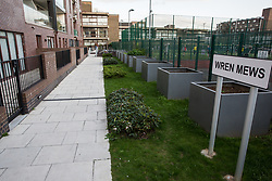 London, UK. 26th March, 2019. Children from Wren Mews, a social housing block, are not permitted to play in a communal play space at Henley Homes' 149-home Baylis Old School complex in Lambeth. Henley Homes and Lambeth Council have been widely criticised because of the manner in which communal play spaces at the development have been segregated so as deny children living in social housing access to play with the children of wealthier families who have purchased accommodation in the development. Planning permission for the development was granted on condition that it include a mix of affordable and social housing.