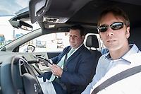 17 JUL 2018, GIFHORN/GERMANY:<br /> Hubertus Heil (L), SPD, Bundesminister fuer Arbeit und Soziales, steuert einen PKW mit einem iPad, waehrend dem Besuch der Ingenieurgesellschaft Auto und Verkehr, IAV, im Rahmen seiner Sommerreise<br /> IMAGE: 20180717-01-009