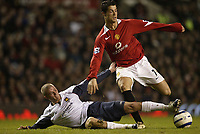 Photo: Aidan Ellis.<br /> Manchester United v West Ham United. The Barclays Premiership. 29/03/2006.<br /> West Ham's Paul Konchesky tackles Manchester's Cristiano Ronaldo