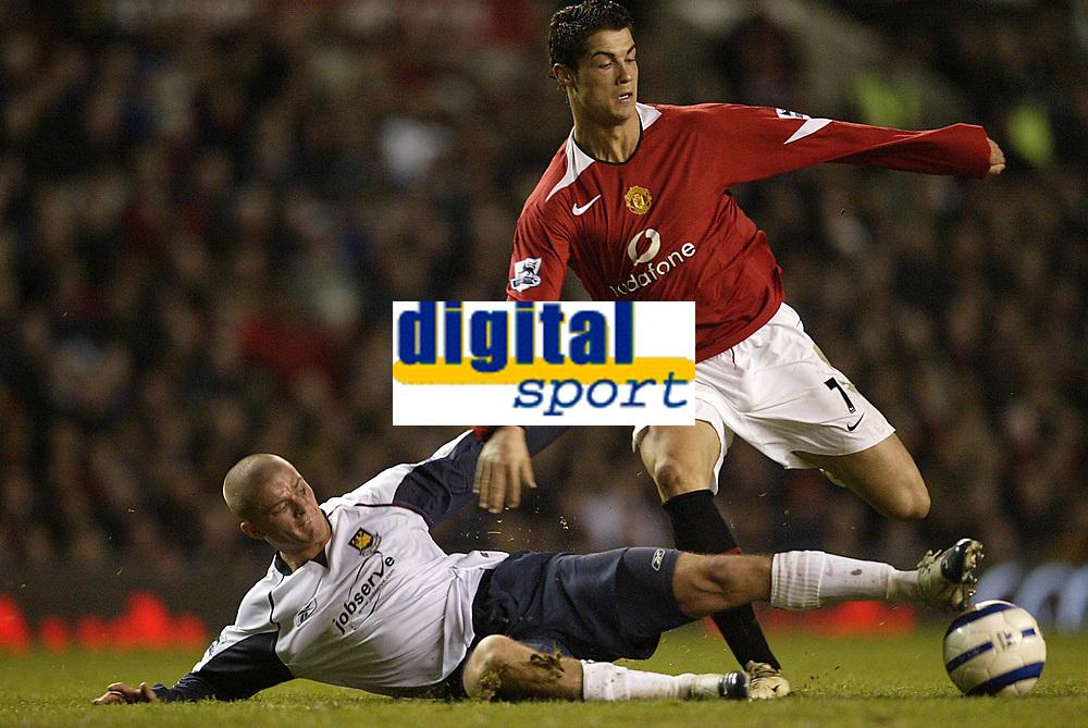 Photo: Aidan Ellis.<br /> Manchester United v West Ham United. The Barclays Premiership. 29/03/2006.<br /> West Ham's Paul Konchesky tackles Manchester's Cristiano Ronaldo