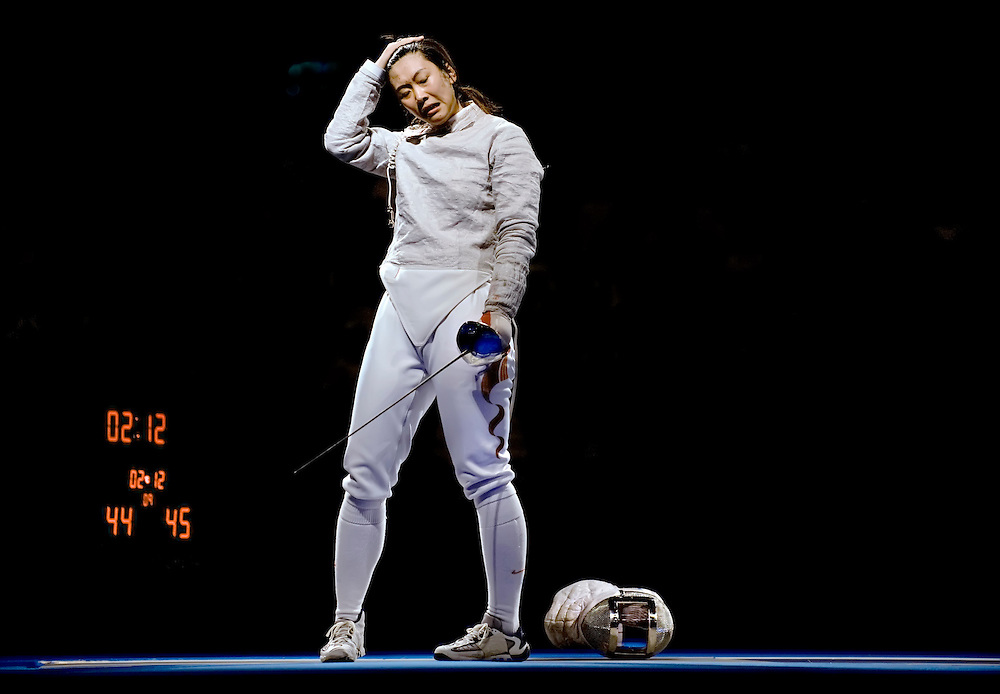 China's Xue Tan reacted to losing the gold medal on the final point of the women's team sabre to Ukraine, 45-44. The previous point, which was disputed, was called a draw during the 2008 Summer Olympic Games in Beijing, China. (photo by David Eulitt / MCT)
