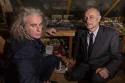 Brothers Simon, 53 and Paul Hurst, 58 have some of their late father's ashes carried around his extensive model railway in the loft of his home. PICTURED: Simon, left, and Paul at Ashurst Station on their late father Peter's model railway, built into the loft above his home. Leeds, Kent, March 15 2018.