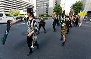 A marching band of anarchists at an anti nuclear protest. Tokyo, Japan Sunday June 2nd 2013
