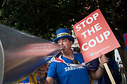 Anti Brexit protester Steve Bray with his loud hailer with message to Stop the Coup in Westminster on the day that Parliament reconvenes after summer recess to debate and vote on a bill to prevent the UK leaving the EU without a deal at the end of October, on 3rd September 2019 in London, England, United Kingdom. Today Prime Minister Boris Johnson will face a showdown after he threatened rebel Conservative MPs who vote against him with deselection, and vowed to aim for a snap general election if MPs succeed in a bid to take control of parliamentary proceedings to allow them to discuss legislation to block a no-deal Brexit.