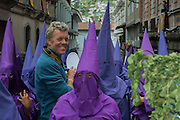Cucuruchos during the Good Friday Procession commemorating the Passion and Death of Jesus Christ & Pete Oxford<br /> Quito<br /> ECUADOR<br /> South America