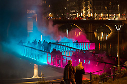 """© Licensed to London News Pictures. 27/02/2020. Bristol, UK. Bristol Light Festival; the artwork """"Pink Enchantment"""" at Castle Bridge, an interactive installation with light and fog activated by people walking on the bridge, from international light artist Tine Bech. This is the launch of the first ever Bristol Light Festival, hosted by Bristol City Centre BID. Internationally renowned artists and local talent lighting up the city with a series of installations this weekend. Photo credit: Simon Chapman/LNP."""