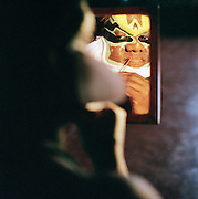 Kathakali dancer applying make-up before a preformance, Kerala, India.