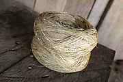 Ball of hemp fibre (cannabis sativa) in the Hmong Lai village of Ban Chalern, Phongsaly province, Lao PDR. Making hemp fabric is a long and laborious process; the end result is a strong durable cloth with qualities similar to linen which the Hmong Lai women use for their traditional clothing. In Lao PDR, hemp is now only cultivated in remote mountainous areas of the north. The remote and roadless village of Ban Chalern is situated along the Nam Ou river and will be relocated due to the construction of the Nam Ou Cascade Hydropower Project Dam 7.