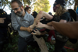 August 27, 2017 - Berkeley, Calif - Anti-right-wing protesters wrestles with a man at MLK Jr. Civic Center Park on Sunday, Aug. 27, 2017 in Berkeley, Calif. (Credit Image: © Paul Kuroda via ZUMA Wire)