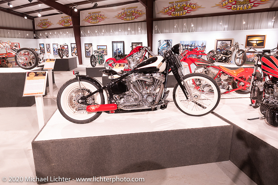 Cherry Bomb, Klock Werks' Brian Klock's custom Harley-Davidson Softail built in 2004, on display in the Heavy Mettle - Motorcycles and Art with Moxie exhibition at the Sturgis Buffalo Chip. This is the 2020 iteration of the annual Motorcycles as Art series curated and produced by Michael Lichter. Sturgis, SD, USA. Friday, August 7, 2020. Photography ©2020 Michael Lichter.