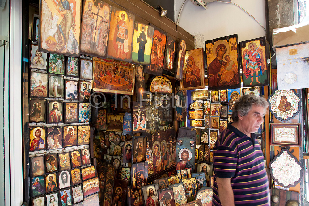 """Shop selling religious icons, paintings and pictures in the area of Monastiraki. Among religions in Greece, the largest denomination is the Greek Orthodox Church, which represents the majority of the population and which is constitutionally recognised as the """"prevailing religion"""" of Greece (making it one of the few European countries with a state religion). Other major religions include Catholicism, Islam and Protestantism. According to a 2005 Eurobarometer Poll, 81% of Greek citizens believe that there is a God, whereas 16% believed in some sort of spirit or life force and 3% responded that they did not believe there is any sort of God, spirit or life force. Athens is the capital and largest city of Greece. It dominates the Attica periphery and is one of the world's oldest cities, as its recorded history spans around 3,400 years. Classical Athens was a powerful city-state. A centre for the arts, learning and philosophy."""