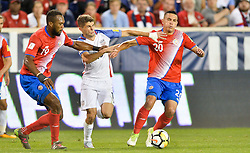 September 1, 2017 - Harrison, NJ, USA - Harrison, N.J. - Friday September 01, 2017:   Kendall Waston, Christian Pulisic, David Guzmán during a 2017 FIFA World Cup Qualifying (WCQ) round match between the men's national teams of the United States (USA) and Costa Rica (CRC) at Red Bull Arena. (Credit Image: © John Todd/ISIPhotos via ZUMA Wire)