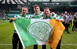 Celtic's Leigh Griffiths (left), Kieran Tierney and Jonny Hayes hold up a Celtic banner as they celebrate winning the Ladbrokes Scottish Premiership match at Celtic Park, Glasgow.