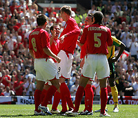 Photo: Paul Thomas.<br /> England v Jamaica. International Friendly. 03/06/2006.<br /> <br /> Peter Crouch (C) of England celebrates his goal with team mates.