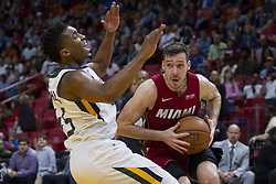 January 7, 2018 - Miami, FL, USA - Miami Heat guard Goran Dragic (0) drives the ball against Utah Jazz's Donovan Mitchell (45) in the fourth quarter on Sunday, Jan. 7, 2018 at the AmericanAirlines Arena in Miami, Fla. The Miami Heat defeated the Utah Jazz, 103-102. (Credit Image: © Matias J. Ocner/TNS via ZUMA Wire)