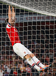 Arsenal Forward Olivier Giroud (FRA) hangs from the Man City cross bar after a shot from Arsenal Forward Lukas Podolski (GER) misses - Photo mandatory by-line: Rogan Thomson/JMP - 07966 386802 - 29/03/14 - SPORT - FOOTBALL - Emirates Stadium, London - Arsenal v Manchester City - Barclays Premier League.