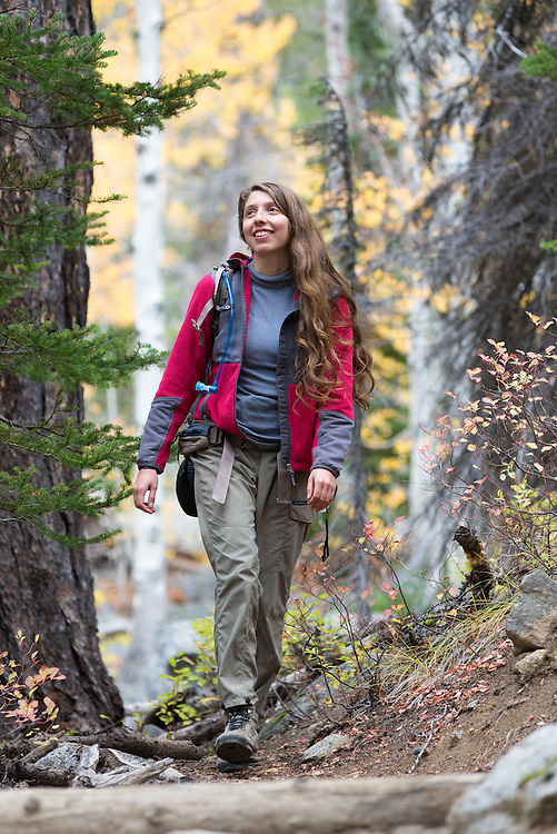 Woman backpacking in the Wallowa Mountains, Oregon.