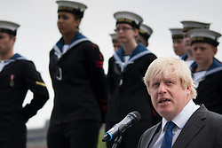 London, June 23rd 2014. Mayor of London Boris Johnson addresses the gathering as members and veterans of the armed forces meet at City Hall for a flag raising ceremony to mark Armed Forces Day.