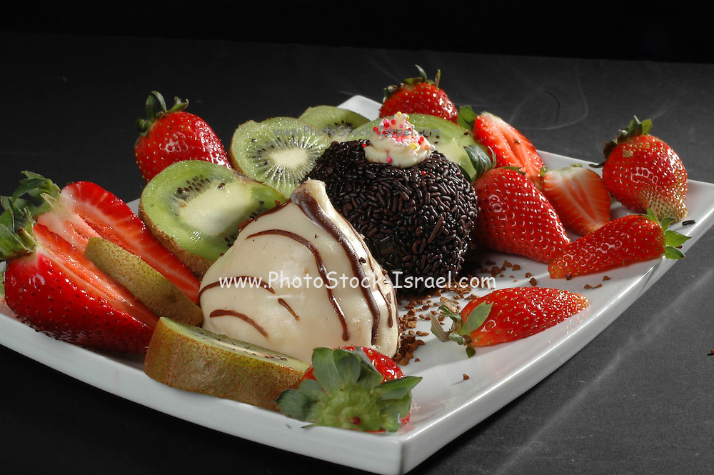 Dessert Helping of cake and cut strawberries and kiwi