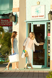 Two women shopping in Naples Florida on a summer day