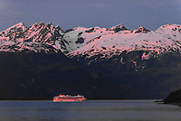"Norwegian Cruise Line ship ""Norwegian Sun"" sailing up the Lynn Canal (the deepest fjord in North America), passing Haines, en route to Skagway, Inside Passage, Southeast Alaska USA."