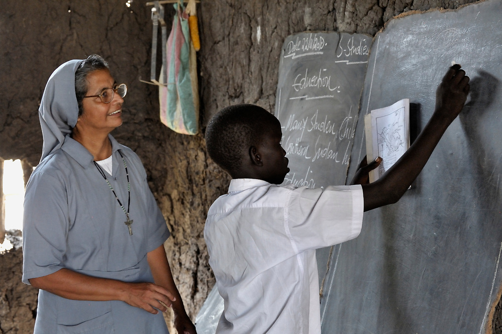 Sister Ninet D'Costa, FMA, a Catholic nun from India, is a teacher trainer in Malakal, Southern Sudan. Sister D'Costa came to the war-torn African country under the auspices of Solidarity with Southern Sudan, an international network of Catholic groups supporting Southern Sudan with educational personnel and prayer. Here Sister D'Costa supervises a teacher's work in a classroom in Detang, a small village across the Upper Nile River from Malakal. NOTE: In July 2011 Southern Sudan became the independent country of South Sudan.