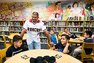 """PHOENIX, AZ - AUGUST 2: Eduardo Escobar and APS surprise a teacher and her 3rd grade class with a $500 Visa gift card to be used for school supplies as part of the APS """"Supply My Class 2.0"""" contest. (Photo by Sarah Sachs/Arizona Diamondbacks)"""
