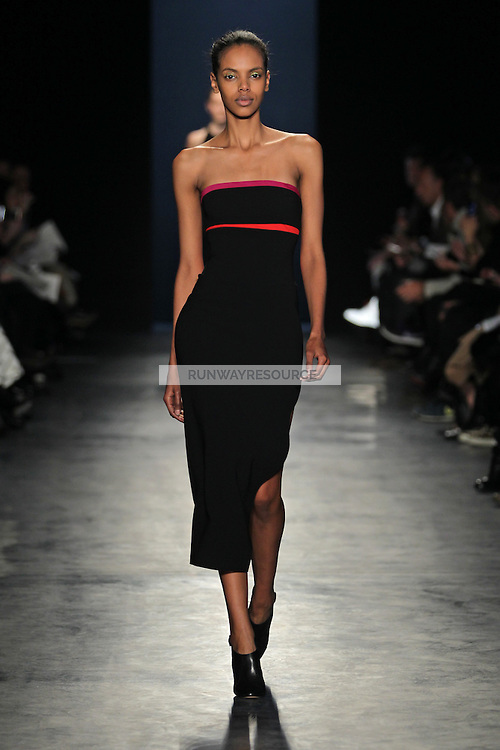 A model walks the runway wearing Altuzarra Fall 2014 in New York on February 8th, 2014