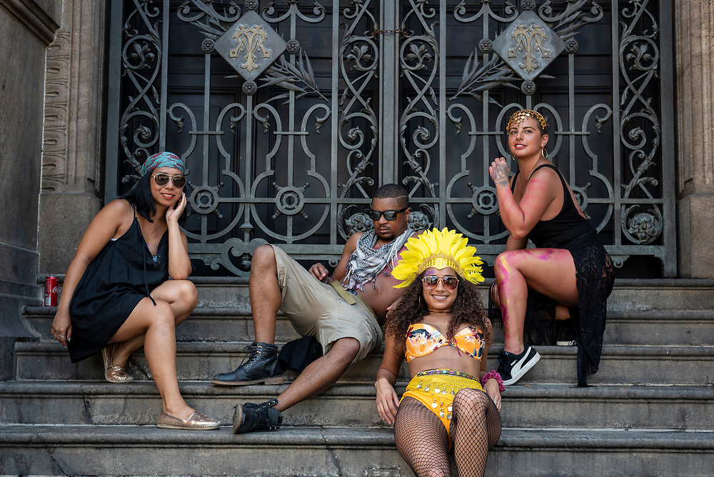 Rio de Janeiro, Brazil - March 10, 2019: Sarah, Darrien, Talitha, and Emeleen, travelers staying at the same hostel in Rio during Carnival, pose for a picture on the steps of the Municipal Theater of Rio de Janeiro.
