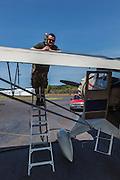 Fueling the 1934 Stinson Reliant SR-5E.