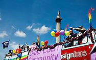 People cheer as they pass by Trafalgar Square during the annual Gay Pride parade in London, Britain, 29 June 2013. BOGDAN MARAN / BPA