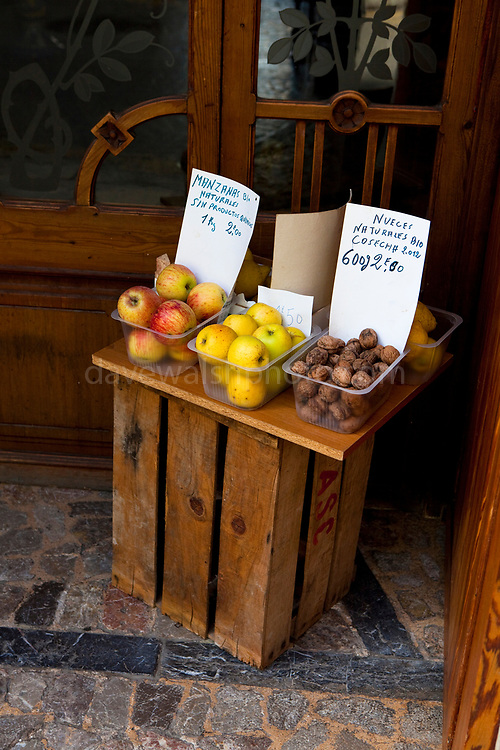 Apples and walnuts. Fruit for sale, in a doorway of a private home, in Soller, Mallorca.