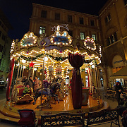 TREVISO, ITALY - DECEMBER 06:  A festive Merry-go-round is seen on December 6, 2011 in Treviso, Italy. Christmas Markets are popular in Northern Italian cities, selling festive items including lights, nativity scenes, decorations and local festive handicrafts. In most cities they will run from the end of November to January 6th. HOW TO LICENCE THIS PICTURE: please contact us via e-mail at sales@xianpix.com or call our offices in London   +44 (0)207 1939846 for prices and terms of copyright. First Use Only ,Editorial Use Only, All repros payable, No Archiving.© MARCO SECCHI