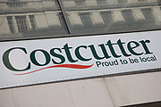Sign for the cornershop supermarket brand Costcutter in Birmingham, United Kingdom.